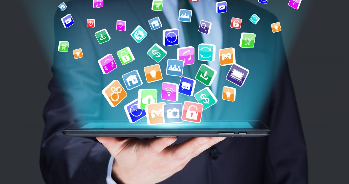 Businessman holding a tablet pc with mobile applications icons on